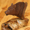 Wood carving of a grizzly bear by Bill Jons