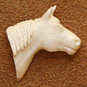 View a larger carved antler tie tack by Bill Jons
